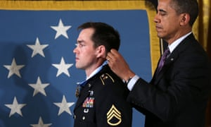 Barack Obama presents the Medal of Honor for conspicuous gallantry to Clinton Romesha, a former active duty Army Staff Sergeant, at the White House. Romesha received the Medal of Honor for his leadership during a daylong attack by hundreds of fighters on Combat Outpost Keating in Afghanistan in 2009.