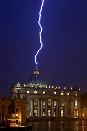 A lightning bolt appears to strike the dome of St.Peter's basilica during a storm in the Vatican City, Rome.