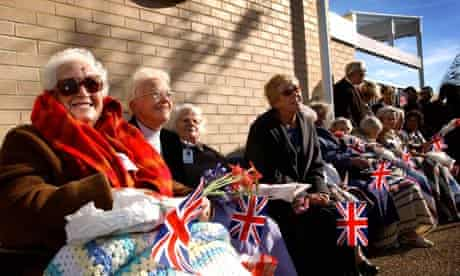 Elderly well wishers with union jack flag