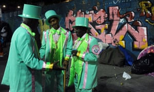 Members of Mangueira samba school chat prior to a parade on the fourth day of the Rio Carnival.