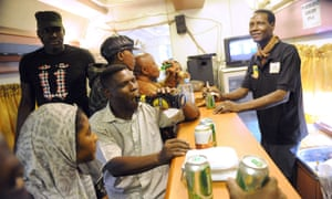 Passengers drink at the bar onboard the Lagos-Kano route train. The rejuvenated Nigerian Railway Corporation has resumed passenger and haulage services on the route following the refurbishment of engines and coaches.