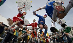 """People take part in the Springerzug carnival parade in Herbstein, Germany. The Springerzug, which translates as """"jumping parade"""", is an interpretation of a carnival tradition particular to Herbstein."""