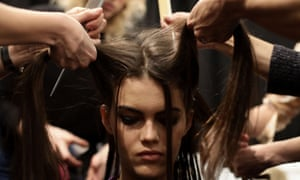 A model has her hair styled before wearing a design by Kaufmanfranco at New York Fashion Week.