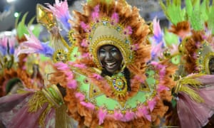Revelers of Mangueira samba school perform during the second night of Carnival parades at the Sambadrome in Rio de Janeiro, Brazil.