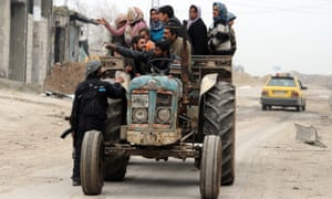 Syrian civilians flee the violence in the Sheikh Said district of the northern city of Aleppo on Sunday. Syrian rebels launched fierce assaults on regime troops in several parts of the country, including near Deir Ezzor where they used tanks to shell an army brigade.