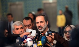 Moaz al-Khatib, president of the National Coalition for Syrian Revolutionary and Opposition Forces, talks to the press following his meeting with Arab League secretary general Nabil al-Arabi in Cairo.