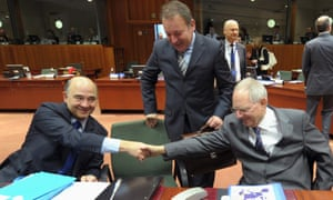 France's finance minister Pierre Moscovici (on the left) shakes hands with Germany's finance minister Wolfgang Schauble at the Eurogroup meeting yesterday. The pair are at loggerheads over the rising value of the euro.