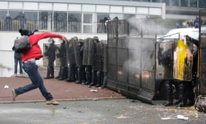 A demonstrator throws eggs at riot police during a demonstration against job cuts in front of tyre maker Goodyear Dunlop France headquarters in Rueil Malmaison. U.S. tyremaker Goodyear confirmed last month the project to close a French plant near the northern city of Amiens, which, if undertaken, would lead to the layoff of 1,173 jobs. Photograph: Jacky Naegelen/Reuters