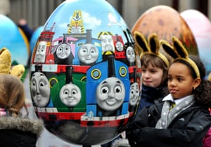 Easter Egg hunt: A group of young girls study a brightly painted giant Easter Egg, which is one of 100 that will be hidden in cities throughout the country from today until the 1st April, as part of the Lindt Big Egg hunt in support of the Action for Children Charity in central London.