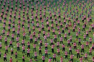 A record breaking event: People take part in an attempt to break the Guinness world record for most number of people simultaneously hula-hooping at Thammasat University stadium in Pathum Thani province. Thailand broke the previous record held by Taiwan, with a new record of 4483 people hula-hooping for 7 minutes. Photograph: Stringer/Thailand/Reuters