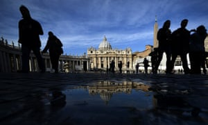 A day of reflection: Tourists and faithful walk on St Peter's square at the Vatican City. The Catholic Church entered uncharted waters the same day after Pope Benedict XVI's shock announcement the day before that he would become the first pontiff to resign in more than 600 years. Photograph: Filipo Monteforte/AFP/Getty Images