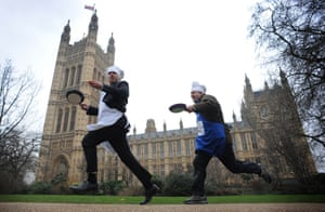 Pancaking it: Tim Loughton MP (left) and Lord Redesdale take part in this year's annual Rehab Pancake Race on Shrove Tuesday outside the Houses of Parliament in London.