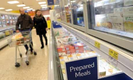 More horsing around: Customers at the frozen prepared meals section at a Tesco's store in London. Tesco's has admitted that some of its Everyday Value Spaghetti Bolognese has contained 60 per cent horse meat, after DNA were carried out.