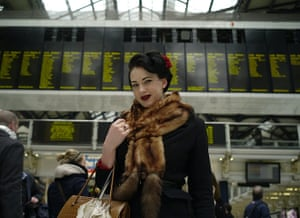 Your Pictures - Glamour: woman dressed in fur against train platform timetable