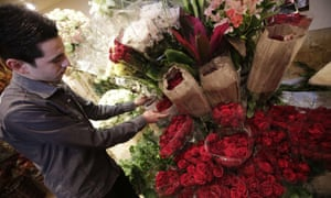 A whiff of normality: A Syrian flower vendor displays red roses at his shop in preparation for Valentine's Day in Damascus.