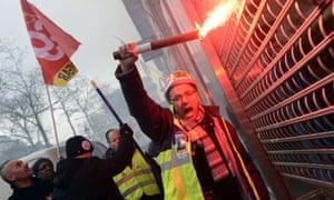 PSA Peugeot Citroen workers protest against job cuts at the car maker's headquarters in Paris. Photogaph: AFP/Getty Images Bertrand Guay.