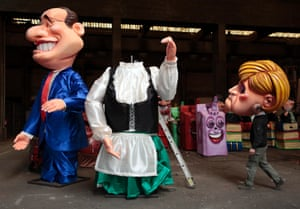 """Head of state: A worker carries the head of a giant figure of German Chancellor Angela Merkel (R) near a figure of French President Francois Hollande (L) during preparations for the carnival parade in Nice. The 129th Carnival of Nice will start on February 15 to March 6 and will celebrate the """"King of the five continents"""". Photograph: Eric Gaillard/Reuters"""
