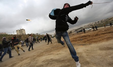 Palestinian student from Bir Ziet university, throws a fire bomb during a clash with Israeli soldiers next to the Israeli military prison Ofer. The clashes occurred during a protest in support of Palestinian prisoners Jailed in Israeli prison.