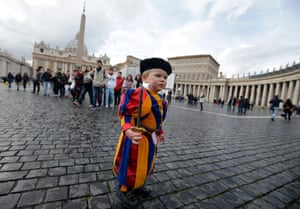 A child dressed as a Swiss Guard stands in St Peter's Square at the Vatican. Pope Benedict stunned the Roman Catholic Church on Monday when he announced he would stand down, saying he no longer had the mental and physical strength to carry on.