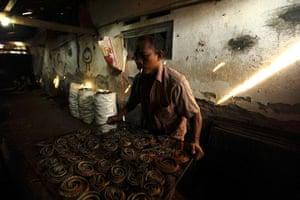 FTA: Beawiharta: Wakira puts a tray of snakes into an oven
