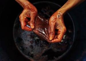 FTA: Beawiharta: A worker holds a piece of snake skin