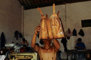 FTA: Beawiharta: A worker looks at a finished bag