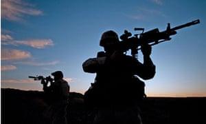 US Navy SEALs during desert combat training.