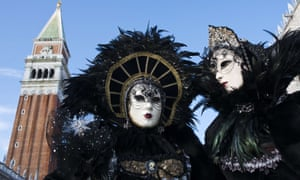 Costumed revellers pose on the last day of the carnival at St Marks' Square in Venice.