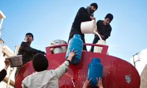 Syrians queue up to collect water for their homes in the Karm al-Myessar neighborhood of Aleppo. The death toll from the Syria civil war is nearing 70,000, UN rights chief Navi Pillay said as she again condemned the UN Security Council's failure to agree action on the conflict.