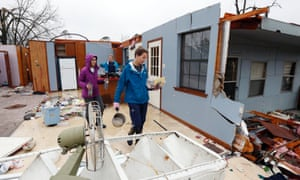 Members of Petal Harvey Baptist Church Youth Ministry walk through the remains of kitchen in Petal, Mississippi. About 50 young people helped families in their cleanup or salvage operations as residents hurried to beat the expected strong afternoon rains.