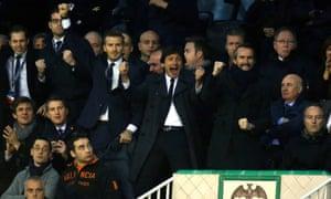 Paris St-Germain's David Beckham celebrates their second goal with their sporting director, Leonardo, and general girector, Jean-Claude Blanc.
