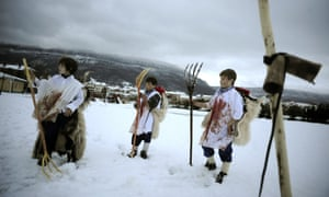 Young boys wear costumes of Momotxorro, a local mythical mountain animal, during the Alsasua carnival in Northern Spain. During the traditional carnival local residents cover their clothes, arms and face with cow blood and parade around the village.