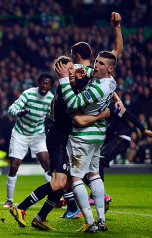 Tuesday Champions League3: Juventus' Stephan Lichtsteiner tussles with Celtic's Gary Hooper