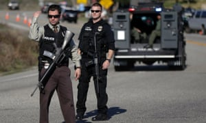 Police block Highway 38 during the hunt for accused killer and ex-Los Angeles police officer Christopher Dorner in Yucaipa, California. Dorner is believed to be barricaded in a cabin after a furious gunbattle with police in the mountains of Southern California, authorities said.