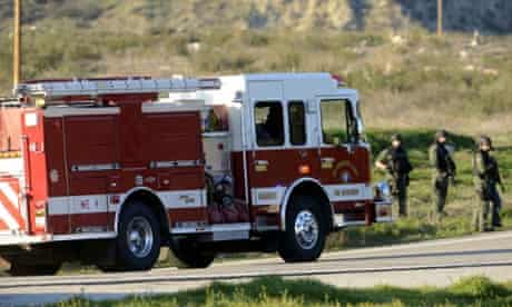 A fire truck passes through a police road block on Highway 38 into the Big Bear area after a shoot-out with suspected fugitive Christopher Dorner.