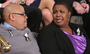 Cleopatra Cowley-Pendleton and Nathaniel A Pendleton Sr of Chicago, Illinois, whose daughter was murdered on 29 January, attend the state of the union address.