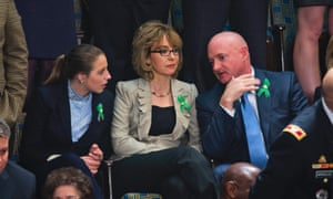 Shooting victim and former Arizona representative Gabrielle Giffords and her husband Mark Kelly, right, at the state of the union address in Washington.