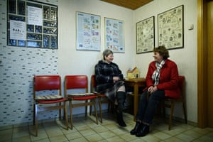 Germany's smallest bank: Two women sit in the waiting room of Germany's smallest bank