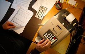 Germany's smallest bank: An old adding-machine at the bank