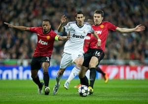 Real v United: Angel Di Maria brushes aside Patrice Evra and Michael Carrick