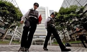 Police patrol outside News International, London