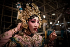 Cantonese opera: An actress adjusts her hat