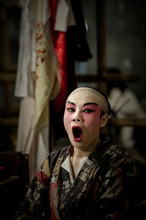 Cantonese opera: An actor yawns backstage