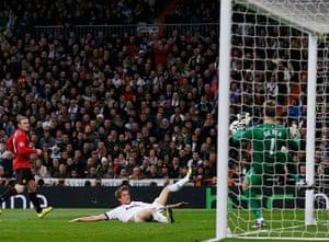 Real v United2:  David De Gea saves a shot by Real Madrid's Fabio Coentrao