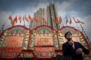 Cantonese opera: A man stands outside the Bamboo Theatre