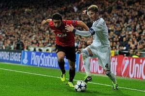 Real Madrid V United: Rafael and Sergio Ramos tussle on the touchline