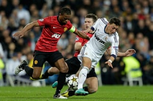 Real Madrid V United 4: Patrice Evra and Michael Carrick are tussling with Mesut Ozit
