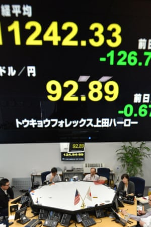 A foreign exchange brokerage in Tokyo yesterday. Japan is cast as the villain in a heated currency drama, accused of driving down the yen's value to shore up its fragile economy.