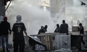 Protestors clash with security forces in the village of Sanabis during a protest to mark the second anniversary of the uprising in Bahrain