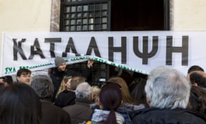 The Social Insurance Institute in Thessaloniki, Greece, where over 500 workers are being laid off. The banner reads OCCUPY.